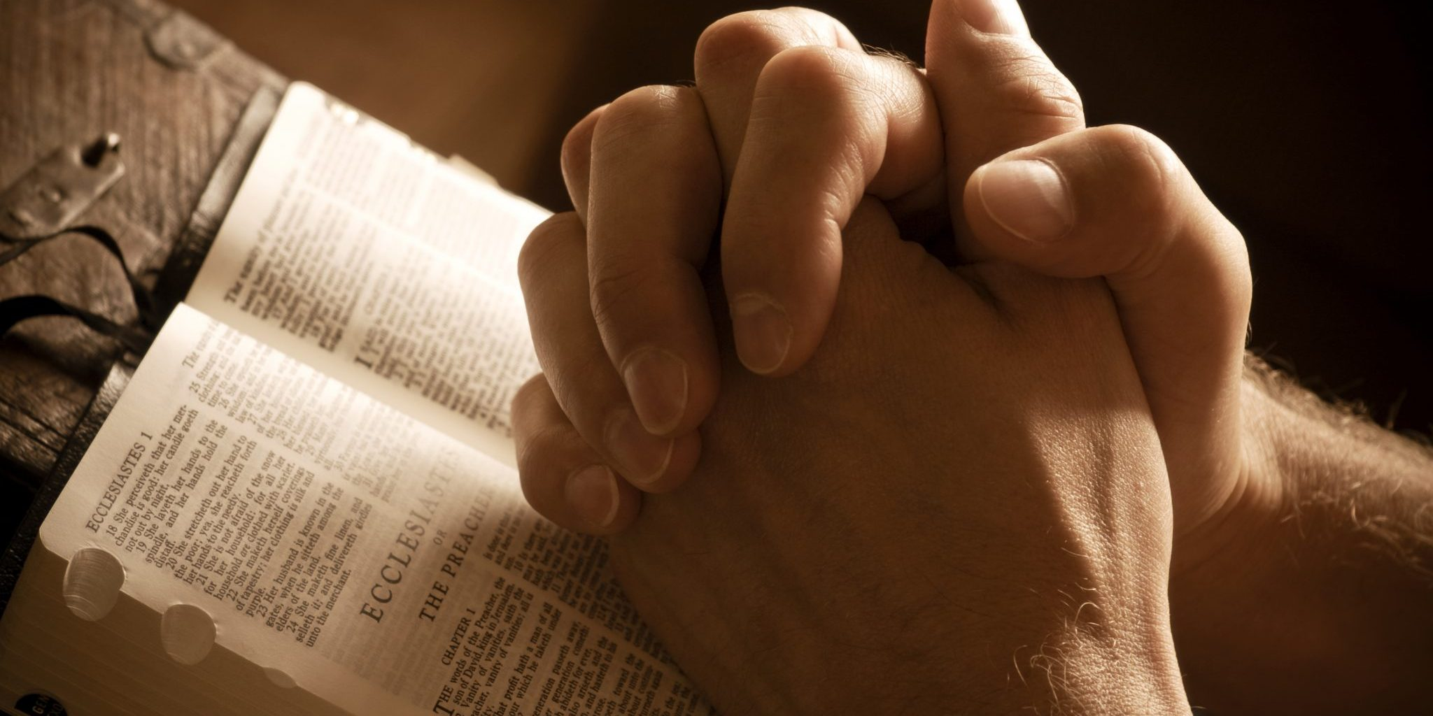 bigstock-Praying-Hands-On-An-Open-Bible-3407461